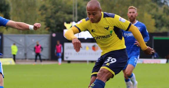 Gino van Kessel crosses past Alex Lacey
